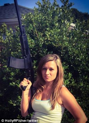 Holly with a gun--liberals hate the example Holly is setting here